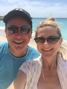 Lisa and her husband on the beach in Antigua